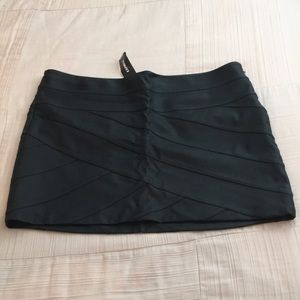 Express Black pleather mini skirt.